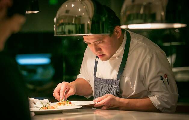 Chef Yu Min Lin cleans plates before they leave the kitchen at The Sea restaurant in Palo Alto, Calif., on Saturday, January 12th, 2013. Photo: John Storey, Special To The Chronicle