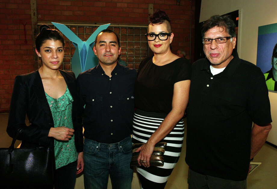 OTS/HEIDBRINK - Artists Adriana Coral, from left, Vincent Valdez, supporter Chris Davila and artist John Hernandez gather at the L.A./S.A. exhibit at Gravelmouth Gallery on 1/12/2013. This is #2 of 2 photos. names checked photo by leland a. outz Photo: LELAND A. OUTZ, SPECIAL TO THE EXPRESS-NEWS / SAN ANTONIO EXPRESS-NEWS