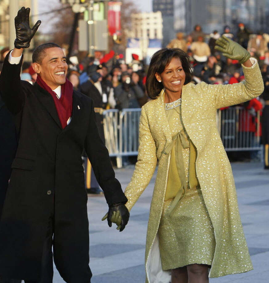 ASSOCIATED PRESS PHOTO  Barack and Michelle Obama walk in his first inaugural parade in January 2009. New York food and wines will be featured at his second inaugural lunch next week, and versions will be available at a free tasting at Wine & Spirits of Slingerlands on Friday. (1/18)