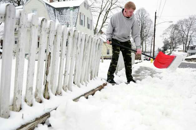 James Shortell shovels the sidewalk in front of his Ansonia, Conn. home Wednesday, Jan. 16, 2013. Photo: Autumn Driscoll / Connecticut Post