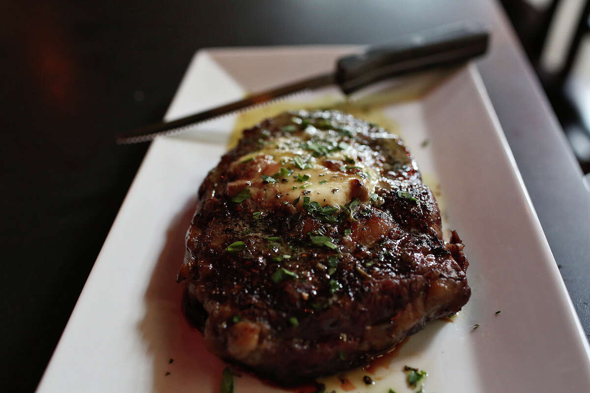 A 14-ounce rib-eye includes a topping of uni butter. Order a veggie dish or two and share.
