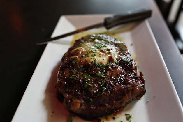 A 14-ounce rib-eye includes a topping of uni butter. Order a veggie dish or two and share. Photo: Lisa Krantz, San Antonio Express-News / San Antonio Express-News