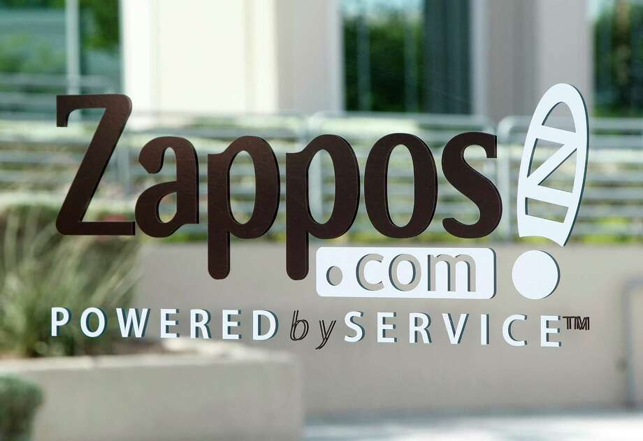 """31. Zappos.com, based in Henderson, Nev. Why is Zappos in this gallery when it's based in Nevada? Because Seattle-based Amazon.com bought the online shoe company in 2009. Last year, when Zappos ranked 11th, Fortune wrote:""""Zappos maintains its zany culture. New last year: Zfrog awards, which let employees pitch new business ideas, and on-site 'laughter yoga' classes."""" Photo: Ethan Miller, Getty Images / 2009 Getty Images"""