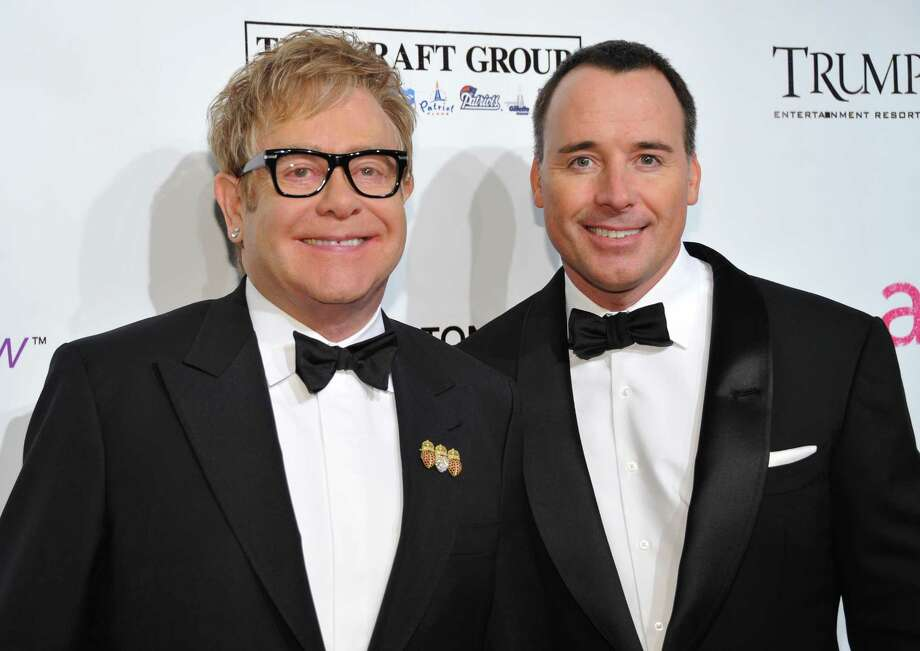 "FILE - In this Oct. 18, 2010 file photo, Sir Elton John, left, and David Furnish attend the Ninth Annual Elton John AIDS Foundation benefit 'An Enduring Vision' at Cipriani Wall Street in New York. Elton John and David Furnish say they have become parents for a second time. The couple say they are ""overwhelmed with happiness"" at the birth of Elijah Joseph Daniel Furnish-John. John's spokeswoman Fran Curtis confirmed an announcement on the singer's website that the baby was born Friday Jan. 11, 2013 in Los Angeles to a surrogate mother, weighing 8 pounds, 4 ounces (3.7 kilograms). (AP Photo/Evan Agostini, File) Photo: Evan Agostini"