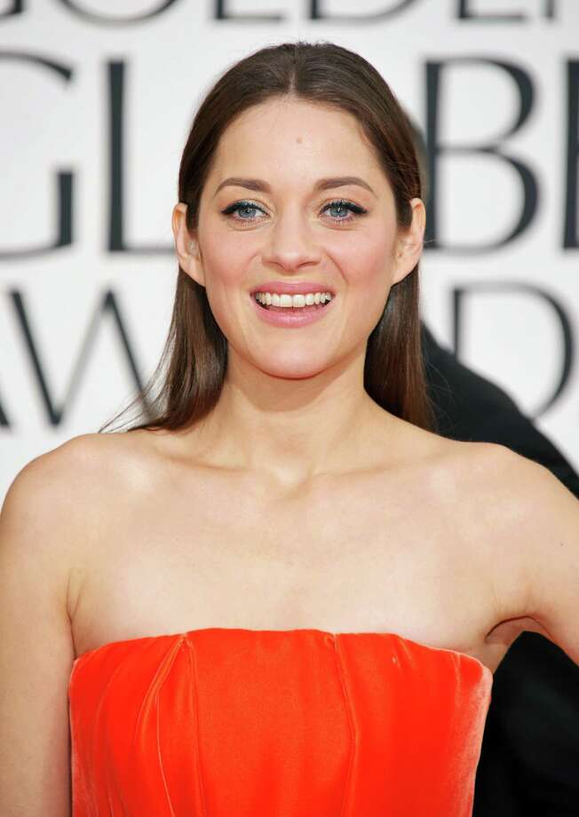"FILE - This Jan. 13, 2013 file photo shows actress Marion Cotillard at the 70th Annual Golden Globe Awards in Beverly Hills, Calif. Cotillard has been named the 2013 Harvard University Hasty Pudding Theatricals Woman of the Year. The French actress, who won the 2007 best actress Oscar for her role in ""La Vie En Rose,"" will be honored with a parade and roast, and given her ceremonial pudding pot, at Harvard on Jan. 31. (Photo by John Shearer/Invision/AP, file) Photo: John Shearer"