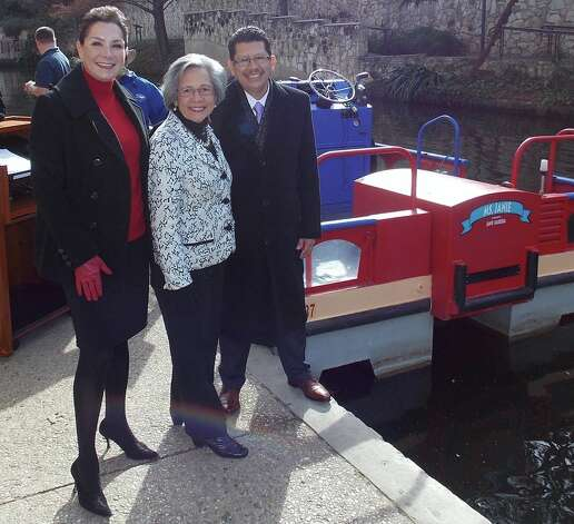 "JoAnn Boone (from left), Janie Barerra and Richard Perez, president of the Greater San Antonio Chamber of Commerce, gather at the chamber's River Walk bank to christen the new barge, ""The Ms. Janie."" Photo: Courtesy Photo / Photo by Ken Slavin"
