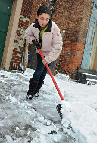 Cheyenne Taylor, 9, of Troy shovels in front of her home during a snow fall on Wednesday Jan. 16, 2013 in Troy, N.Y.  (Lori Van Buren / Times Union) Photo: Lori Van Buren