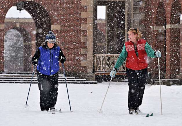 Bobbi Blomquist, left, and Patricia Isabella, both of Johnstown, cross country ski through Saratoga Spa State Park Wednesday morning Jan. 16, 2013.  (John Carl D'Annibale / Times Union) Photo: John Carl D'Annibale / 00020789A