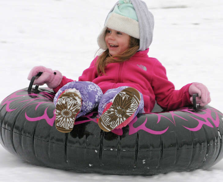 Calli Novak, 4, of Troy smiles while having fun on her tube at Frear Park on Wednesday Jan. 16, 2013