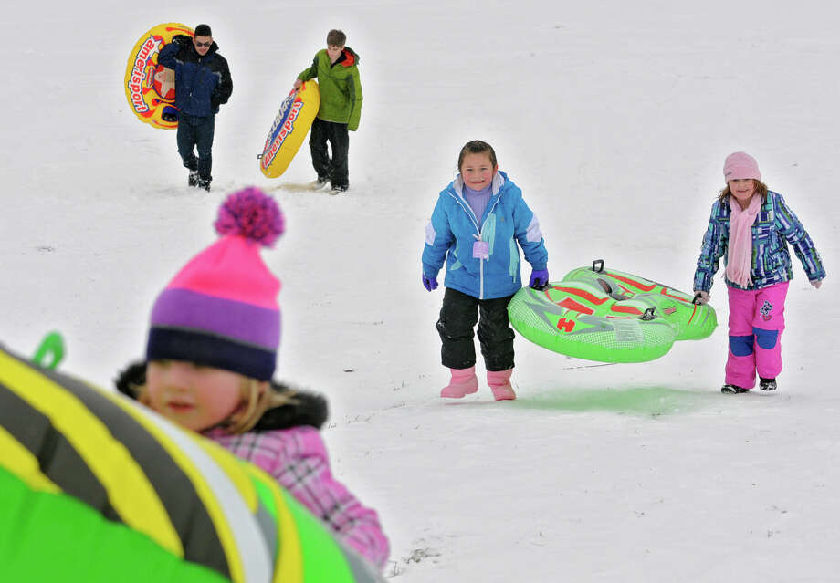 Clockwise from bottom left, Ashlyn Horan, 4, Brandon Mendez, 15, Cameron Bristol, 14, Hailee Rose, 6, and Hailey Laranjo, 5, all of Troy, make the climb back up a hill with their tubes at Frear Park on Wednesday Jan. 16, 2013 in Troy, N.Y.  (Lori Van Buren / Times Union) Photo: Lori Van Buren