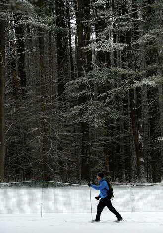 Seth Dunn, of Saratoga Springs uses his lunch hour for a spin around Saratoga Spa State Park on his cross country skis in the snow Jan. 16, 2013 in Saratoga Springs, N.Y. (Skip Dickstein/Times Union) Photo: SKIP DICKSTEIN / 00020789A