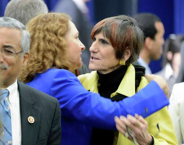 Reps. Elizabeth Esty and Rosa DeLauro embrace at the White House signing of gun control legislation on Wednesday, January 16, 2012. United States President Barack Obama and Vice President Joe Biden made remarks at the event at the White House in Washington, D.C. to unveil a set of proposals to reduce gun violence. Photo: Ron Sachs, Ron Sachs - CNP / ©2013 Ron Sachs from Consolidated News Photos All Rights Reserved Connecticut Post contributed