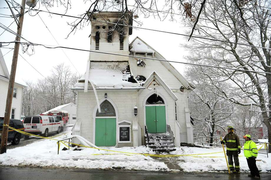 Officials investigate damage to the Second Reformed Church, Wednesday afternoon, Jan. 16, 2013, in the village Philmont in Claverack, N.Y. The 175-year-old church was heavily damaged by a fire which started Tuesday evening. (Paul Buckowski / Times Union) Photo: Paul Buckowski / 00020805A