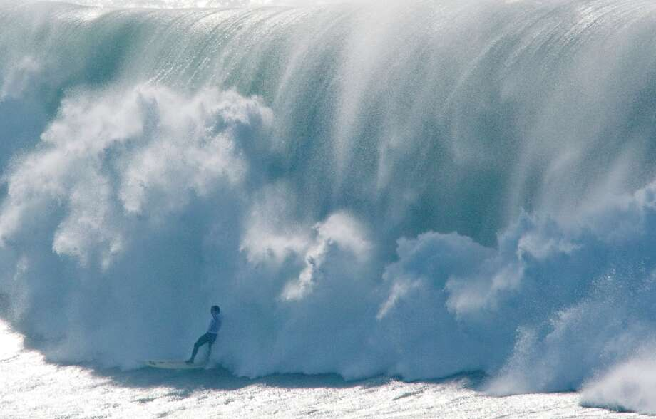 A surfer is devoured by waves during the finals of the Mavericks Surf Contest in Half Moon Bay, Calif. on Saturday, Feb. 13, 2010. Photo: Adam Lau, The Chronicle / SFC