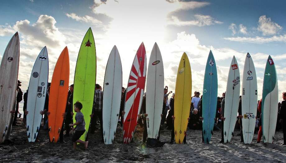 Surfers line up with their surf boards before paddling into the ocean during the opening ceremony for the Mavericks Surf Contest at Mavericks Beach in Princeton by the Sea, Calif., on Friday, November 9th, 2012. Photo: John Storey, Special To The Chronicle / ONLINE_Yes