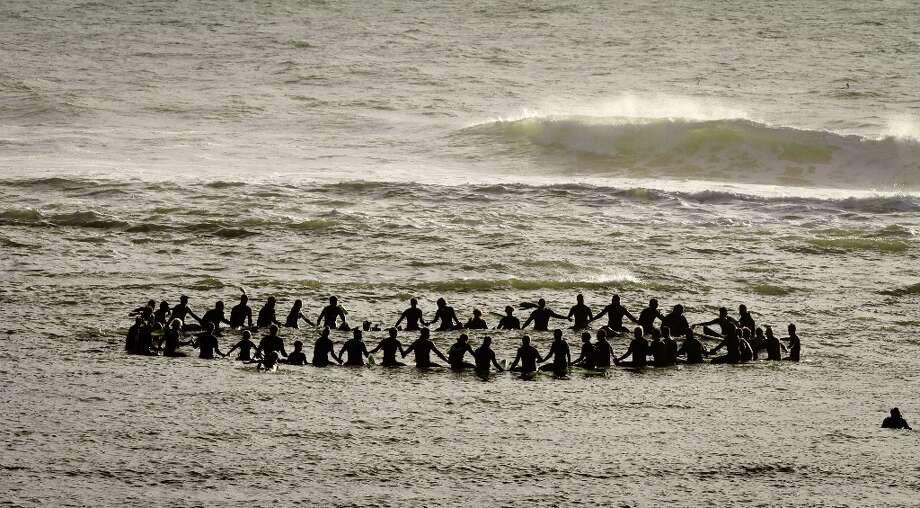 Surfers form a circle in the ocean during the opening ceremony for the Mavericks Surf Contest off of Mavericks Beach in Princeton by the Sea, Calif., on Friday, November 9th, 2012 Photo: John Storey, Special To The Chronicle / ONLINE_Yes