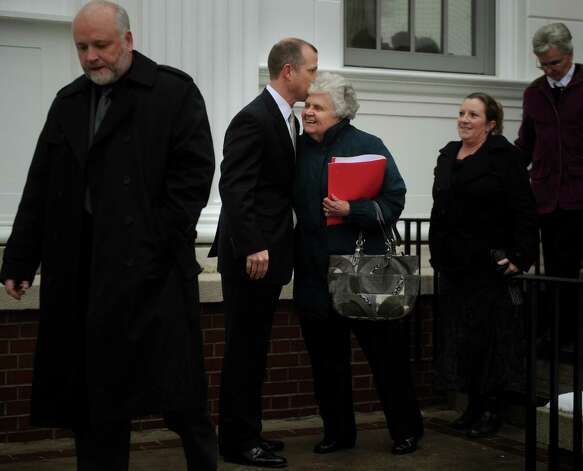 State's attorney Kevin D. Lawlor kisses Lois Krakowski, grandmother of Ashlie Krakowski, following the sentencing of former Milford police officer Jason Anderson at Superior Court in Milford on Wednesday, January 16, 2013. Anderson received a sentence of ten years suspended after five for two counts of misconduct with a motor vehicle and one count of reckless driving for the high speed crash that killed Orange teens David Servin and Ashlie Krakowski on June 13, 2009 on the Post Road in Orange. Photo: Brian A. Pounds