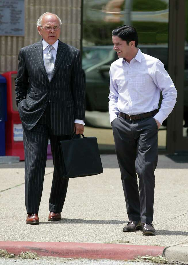 Alex Garcia, right, part owner of Bexar Towing/Roadside Recovery Specialist Inc., walks with attorney Bebb Francis, left,to the Frank D. Wing Municipal Court Building for a pretrial hearing on pending citations, Tuesday, August 21, 2012. Photo: BOB OWEN, San Antonio Express-News / © 2012 San Antonio Express-News