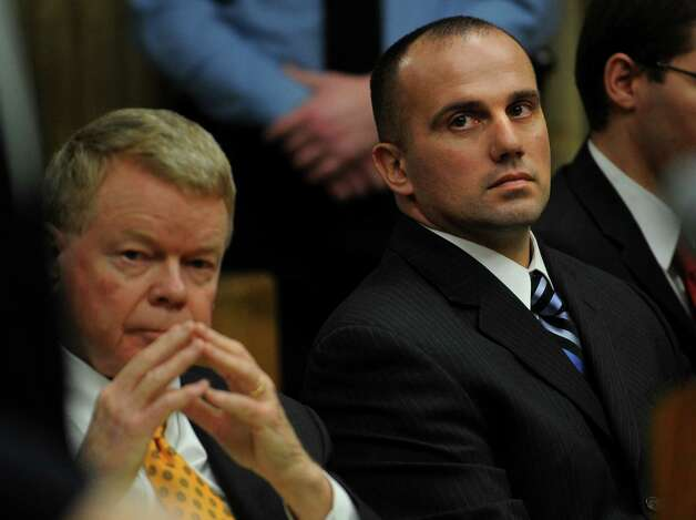 Sitting with his lawyer Hugh Keefe, left, former Milford police officer Jason Anderson listens during sentencing proceedings at Superior Court in Milford on Wednesday, January 16, 2013. Anderson was sentenced to ten years suspended after five on two counts of misconduct with a motor vehicle and one count of reckless driving for the high speed crash that killed Orange teens David Servin and Ashlie Krakowski on June 13, 2009 on the Post Road in Orange. Photo: Brian A. Pounds