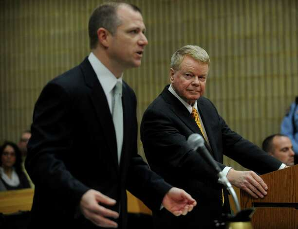 State's Attorney Kevin D. Lawlor, left, and defense attorney Hugh Keefe address the judge during the sentencing of former Milford police officer Jason Anderson at Superior Court in Milford on Wednesday, January 16, 2013. Anderson was found guilty on two counts of misconduct with a motor vehicle and one count of reckless driving for the high speed crash that killed Orange teens David Servin and Ashlie Krakowski on June 13, 2009 on the Post Road in Orange. Photo: Brian A. Pounds
