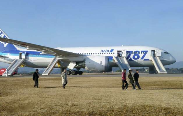 The Federal Aviation Administration grounded Boeing's new 787 Dreamliner Wednesday, after an All Nippon Airways 787 made an emergency landing at Takamatsu airport in Takamatsu, Japan. ANA said a cockpit message showed battery problems and a burning smell was detected in the cockpit and the cabin. It was the latest in a recent string of serious glitches for the composite airliner. Photo: Kyodo News