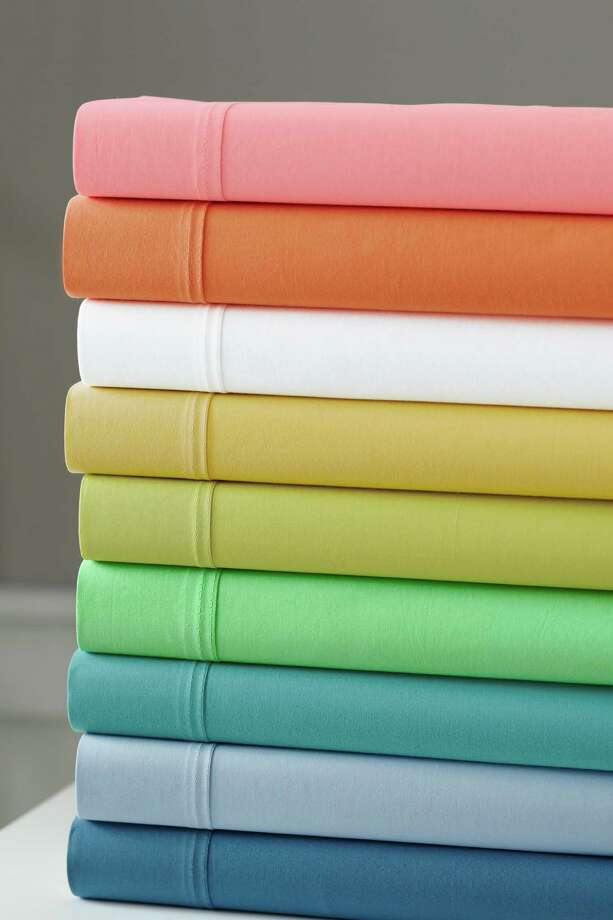 Vibrant colors, such as those in Garnet Hill's Fiesta Percale, are making a comeback in sheets.White, light blue and light green are the top-selling colors. Photo: Courtesy Garnet Hill / Courtesy Garnet Hill