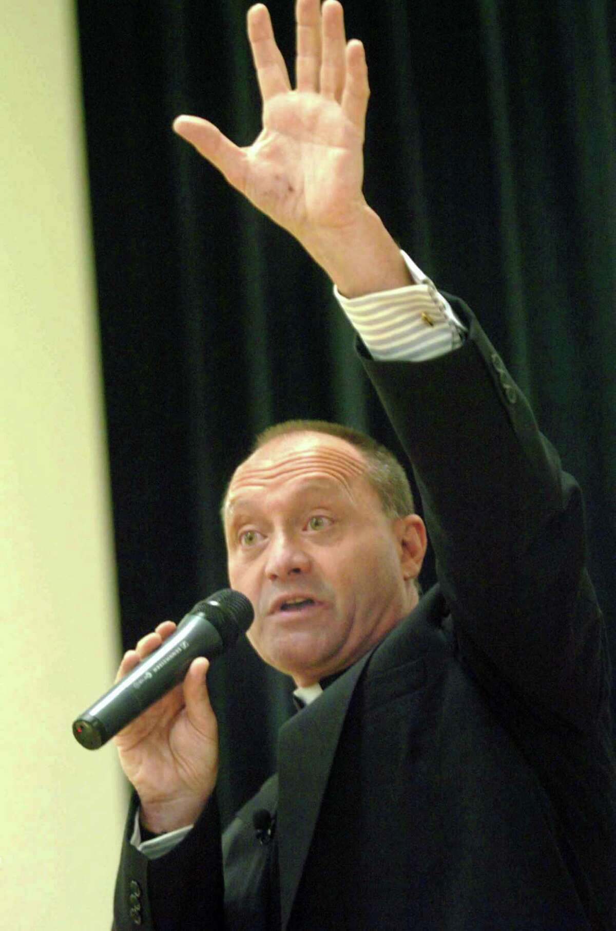 Monsignor Kevin Wallin addresses the faithful, a packed house, at the Cathloic Center on Jewett Avenue, in Bridgeport, Conn. May 4th, 2006.