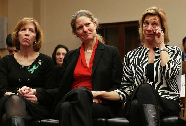 (L-R) Lori Haas, whose daughter was shot and survived at the Virginia Tech shooting, Founder of ProtestEasyGuns.Com Abigail Spangler, and President of Million Mom March Martina Leinz hold hands as they listen to testimony of Superintendent of schools of Newtown, Connecticut, Janet Robinson about the shooting at Sandy Hook Elementary during a hearing before the House Democratic Steering and Policy Committee January 16, 2013 on Capitol Hill in Washington, DC. The committee held a hearing to focus on gun violence prevention. Photo: Alex Wong, Photo By Alex Wong/Getty Images / 2013 Getty Images