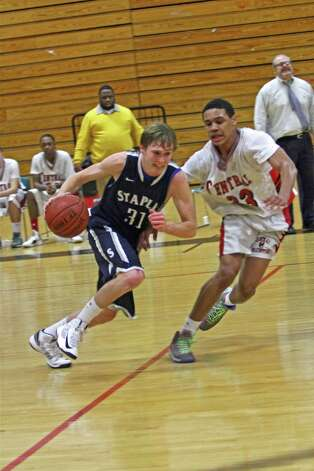 Staples boys basketball guard Peter Rankowitz tries to dribble around Bridgeport Central's Marcus Blackwell in the Wreckers' 73-63 win on Tuesday Jan. 15, 2013 in Bridgeport, Conn. Photo: Contributed Photo