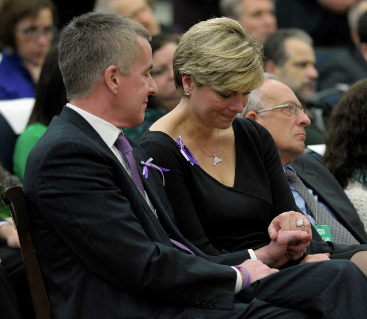 Lynn and Chris McDonnell, whose daughter, Grace, died in the Newtown school shooting, listen as President Barack Obama talks about her in a news conference.