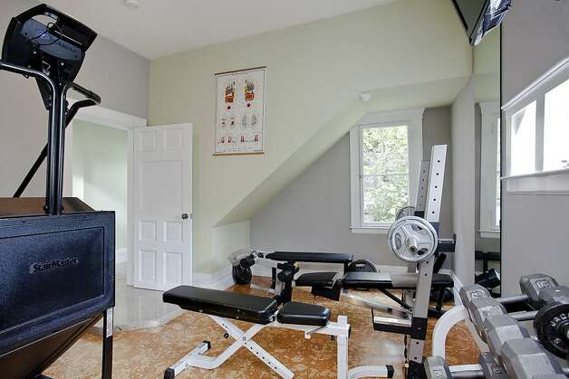 Among the home's many amenities are a gym and massage room next to a home theater. Photo: OpenHomesPhotography.com