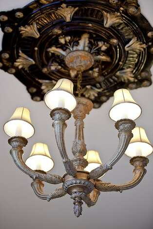 Decorative light fixtures and restored copper ceilings are among the period details. Photo: OpenHomesPhotography.com