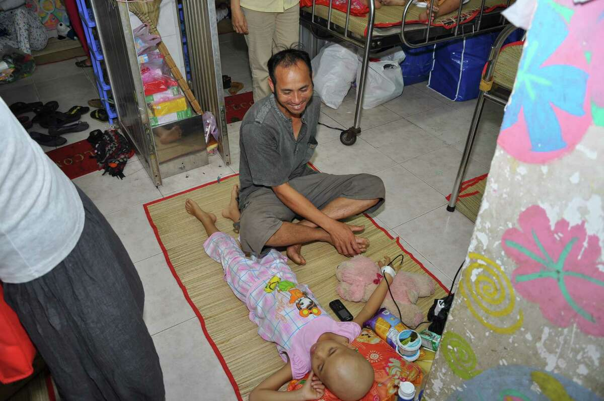 A girl patient with her father in the crowded Oncology Hospital.