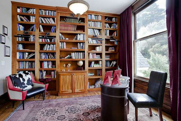 The library features built-ins like the bookcase. Photo: OpenHomesPhotography.com