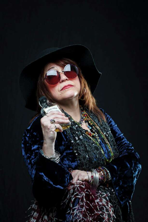 "Myrna Sanders portrays Janis Joplin in her cover band ""Kozmic Pearl"" and is photographed in the Houston Chronicle Photo Studio,Tuesday, Jan. 15, 2013, in Houston.  Saturday will be the 70th anniversary of Joplin's birthday.  ( Michael Paulsen / Houston Chronicle ) Photo: Michael Paulsen, Staff / © 2013 Houston Chronicle"