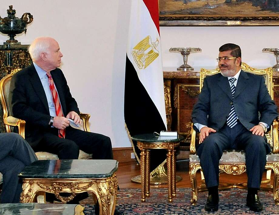 In this image released by the Egyptian Presidency, Egyptian President Mohammed Morsi, right, meets with Republican Sen. John McCain, at the Presidential Palace in Cairo, Egypt, Wednesday, Jan. 16, 2013. Morsi met with McCain in Cairo on Wednesday, for a visit expected to last three days. The meeting comes after the Obama administration on Tuesday gave a blistering review of remarks that the Egyptian President made almost three years ago about Jews and called for him to repudiate what it called unacceptable rhetoric. (AP Photo/Egyptian Presidency) Photo: Uncredited, Associated Press