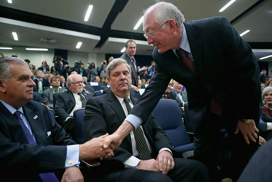 Interior Secretary Ken Salazar (right) greets Transportation Secretary Ray LaHood at an event where President Obama signed gun-control measures. Photo: Chip Somodevilla, Getty Images