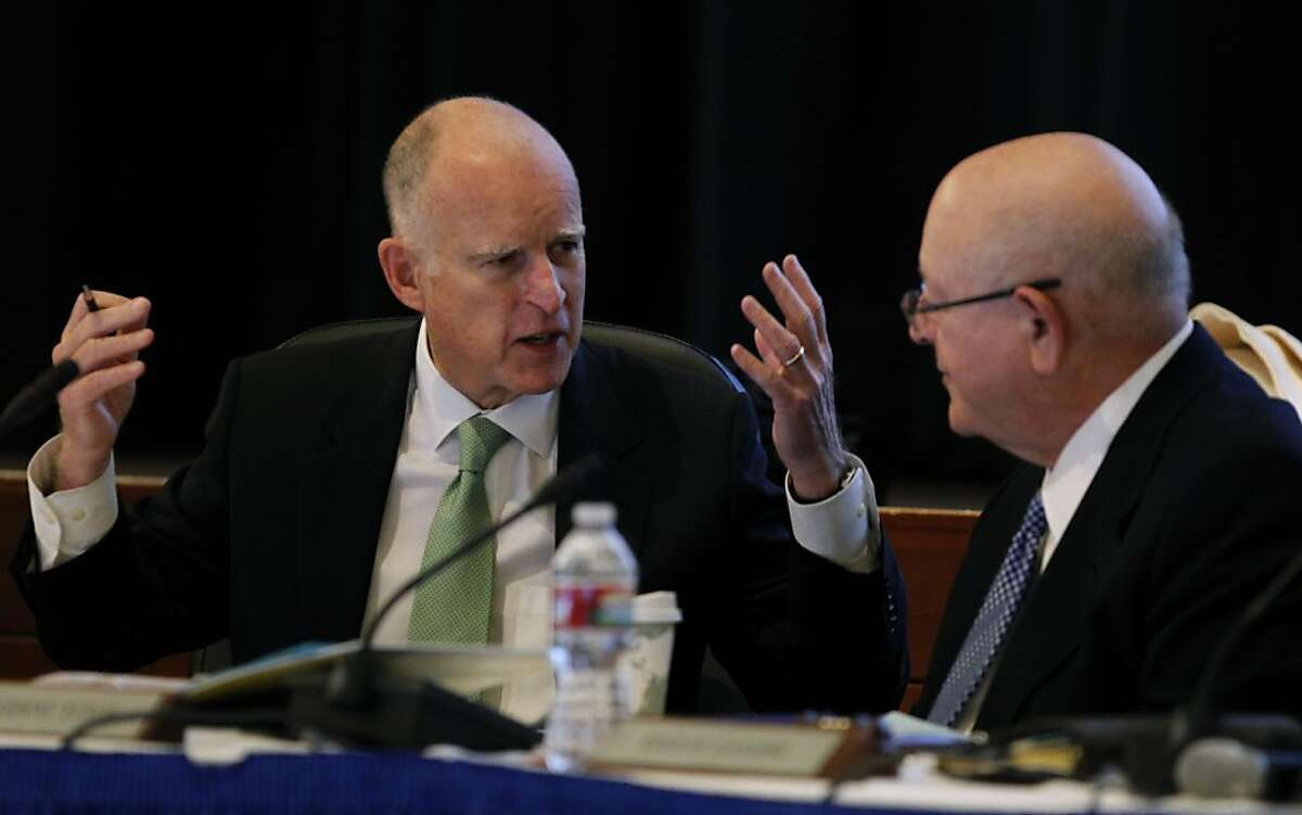 Gov. Jerry Brown chats with UC President Mark Yudof at the UC Board of Regents meeting at the UCSF Mission Bay campus in San Francisco, Calif. on Wednesday, Jan. 16, 2013, when the governor appeared to make a pitch for systemwide online education.
