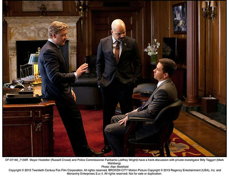 BROKEN CITY  Mayor Hostetler (Russell Crowe) and Police Commissioner Fairbanks (Jeffrey Wright) have a frank discussion with private investigator Billy Taggart (Mark Wahlberg). Photo: Alan Markfield, Twentieth Century Fox
