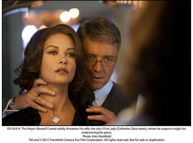 BROKEN CITY  The Mayor (Russell Crowe) subtly threatens his wife, the cityÕs First Lady (Catherine Zeta-Jones), whom he suspects might be undermining his plans. Photo: Alan Markfield, Twentieth Century Fox