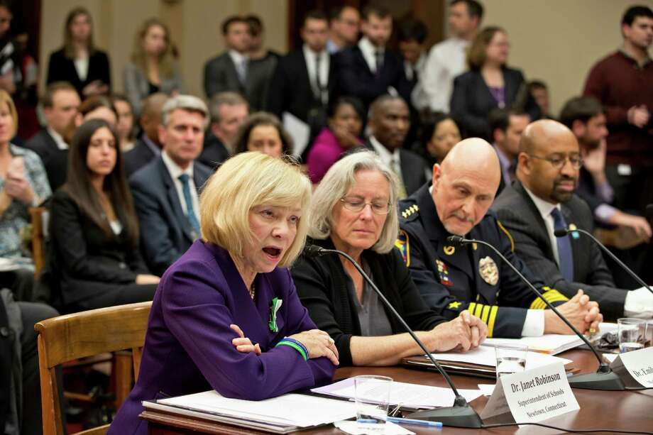 Newtown, Conn. School Superintendent Janet Robinson, left, testifies on Capitol Hill in Washington, Wednesday, Jan. 16, 2013,  before a special hearing on gun violence held by the House Democratic Steering and Policy Committee. From left are, Robinson, Emily Nottingham, mother of Tucson shooting victim Gabe Zimmerman, Chaska, Minn. Police Chief Scott Knight, and Philadelphia Mayor Michael Nutter. Photo: J. Scott Applewhite, AP Photo/J. Scott Applewhite / Associated Press
