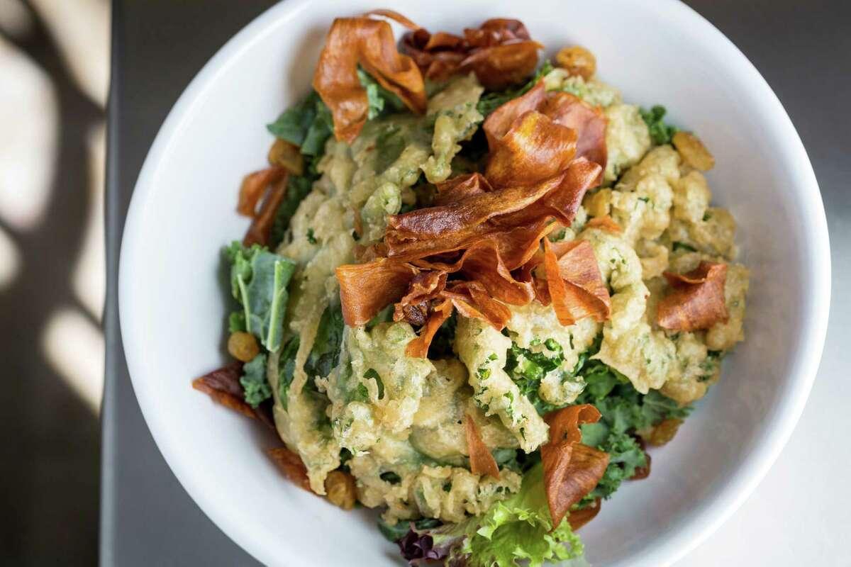 "The ""Kale Salad"": raw and tempura kale, sweet potato chips, pickled golden raisins and white miso vinaigrette at Eatsie Boys Cafe. ( Michael Paulsen / Houston Chronicle )"