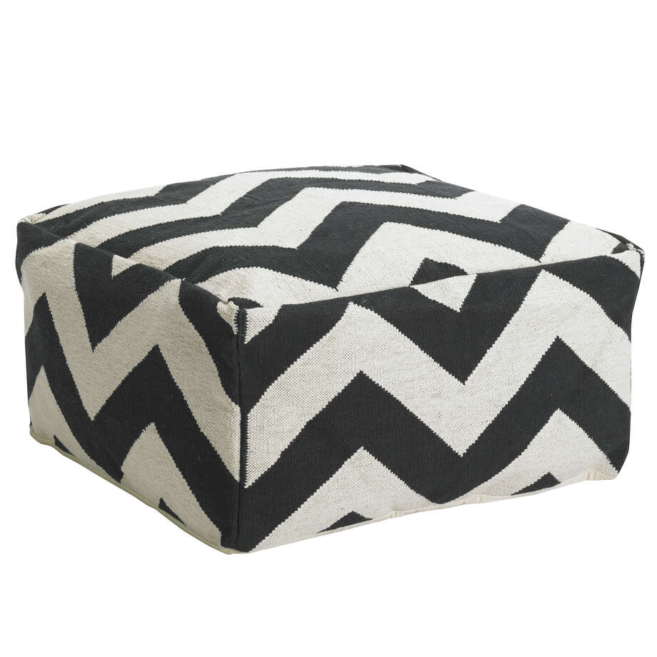 Instead of: A bean bag or inflatable furnitureChoose: Low-slung seating like a pouf or floor pillow, like this chevron version from West Elm. / ©SF Digital Studio, Inc. 2011 All Rights Reserved