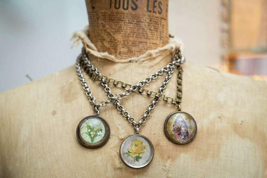 Necklaces with vintage horse bridle rosettes.  Photo: Michael Paulsen, Staff / © 2013 Houston Chronicle