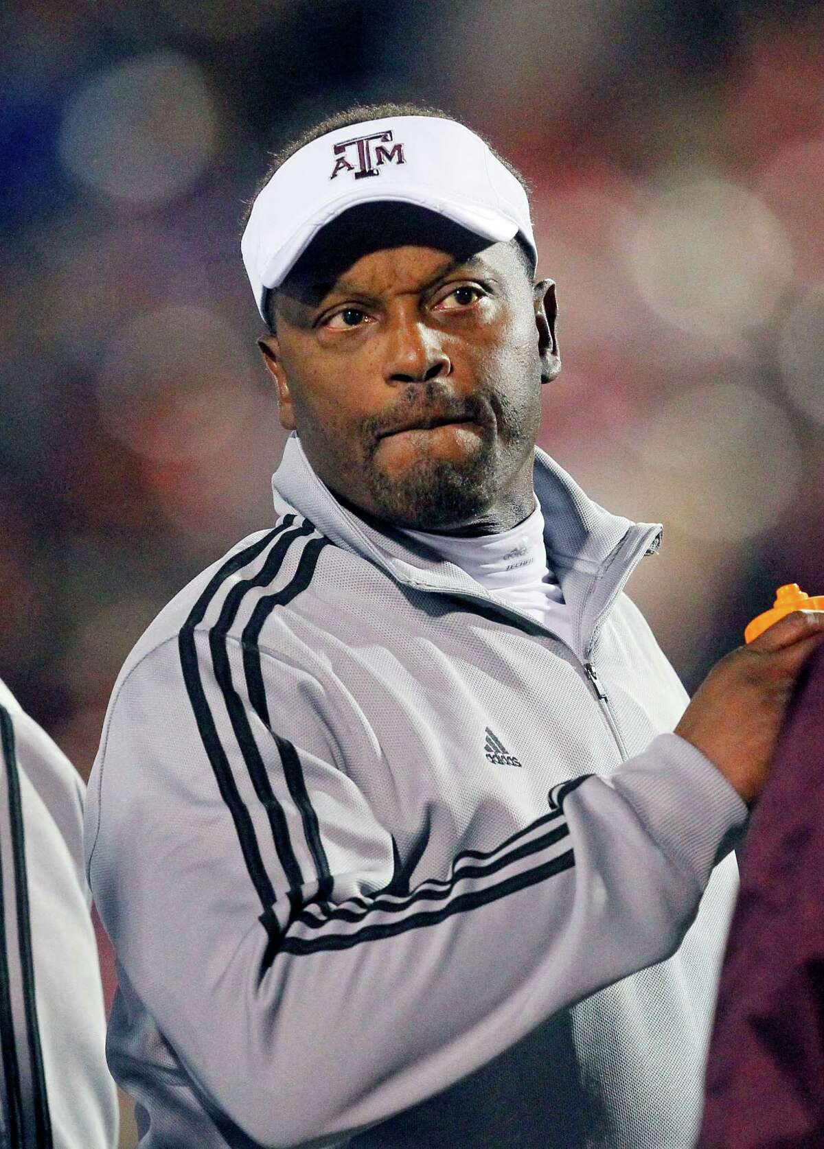 Texas A&M football coach Kevin Sumlin looks downfield in the third quarter of their NCAA college football game against Mississippi in Oxford, Miss., Saturday, Oct. 6, 2012. Texas A&M won 30-27. (AP Photo/Rogelio V. Solis)