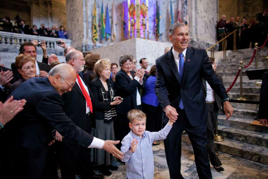 Washington State Governor Jay Inslee walks with his grandson Brody, 4, to his inauguration. Photo: JOSHUA TRUJILLO, SEATTLEPI.COM / SEATTLEPI.COM
