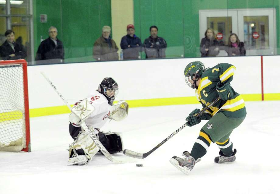Pam Schulman, right, of Greenwich Academy, dekes Gunnery goalie Sam Walther before Schulman scored the first goal of the game during the girls high school hockey game between Greenwich Academy and The Gunnery at Chelsea Piers in Stamford, Wednesday afternoon, Jan. 16, 2013. Photo: Bob Luckey / Greenwich Time