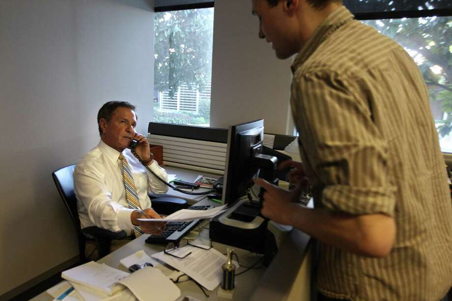 Bob Allen, Channel 13 Sports Anchor, speaks to producer Chaz Miller while preparing for the six o'clock newscast. Photo: Mayra Beltran, Houston Chronicle / © 2013 Houston Chronicle