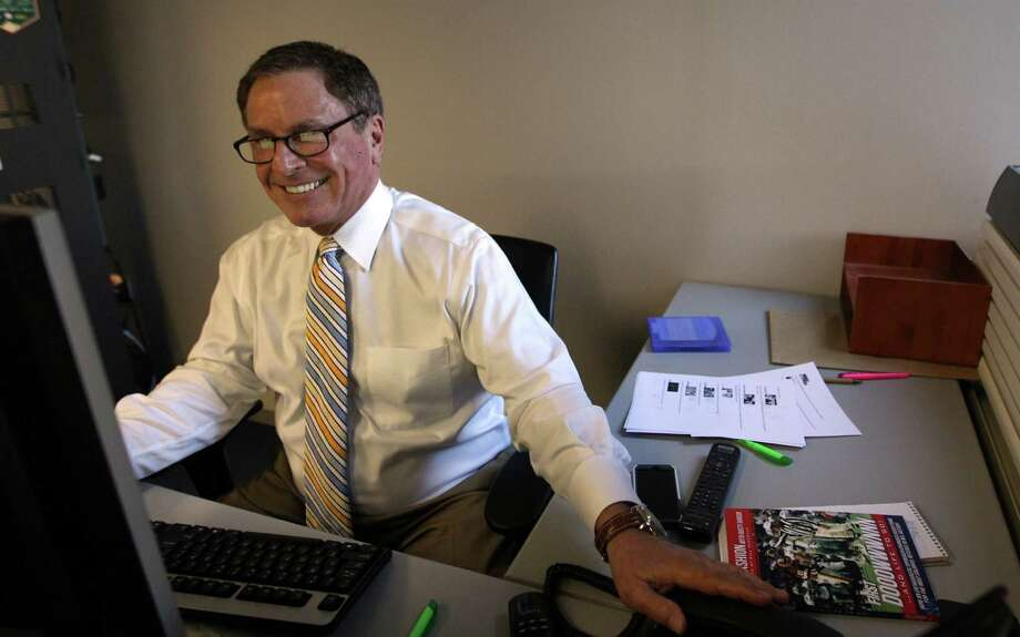 Bob Allen, Channel 13 Sports Anchor, smiles after listening to a message from fans wishing him well while trying to prepare for the evening newscast. Photo: Mayra Beltran, Houston Chronicle / © 2013 Houston Chronicle