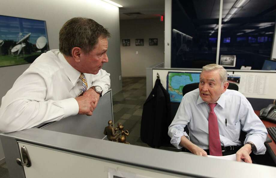 Bob Allen visits News Anchor Dave Ward while preparing for the evening newscast. Photo: Mayra Beltran, Houston Chronicle / © 2013 Houston Chronicle